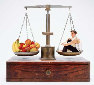 Balance scale with fruit