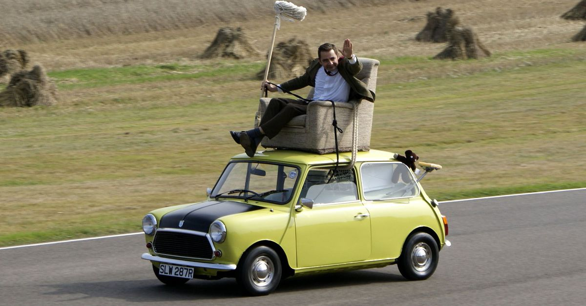 A guy riding in an easy chair on the roof of his driverless car