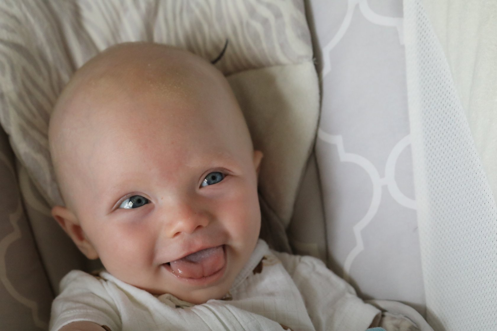 smiling grandson at four months of age